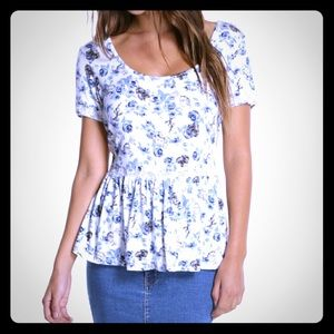 Limited edition beauty and the beast peplum top.